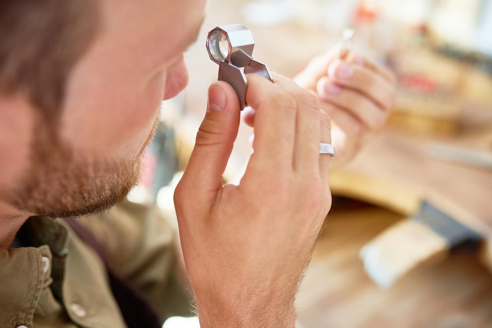 examining jewelry at pawn shop